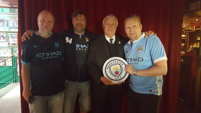 RECOGNITION: Mike Summerbee presents the Swedish Supporter Club with their commemorative plaque.