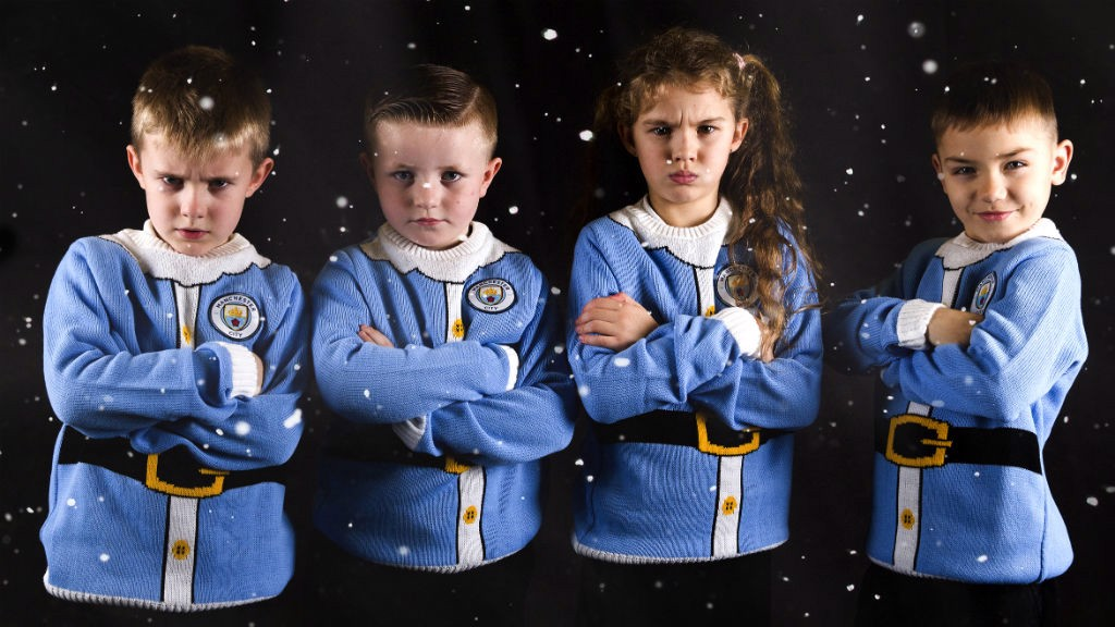 CHRISTMAS CRACKERS: Kevin de Bruyne will no doubt be delighted to have the support of this Team Santa squad!