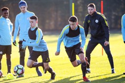 ON THE STRETCH: Phil Foden and Colin Rosler chase the ball down