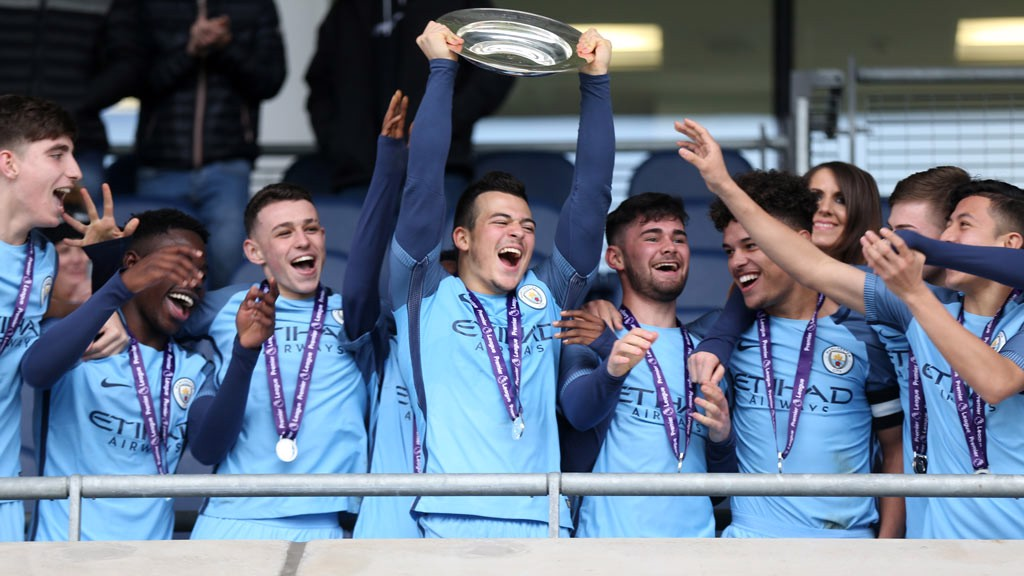 SUPER LORENZO: City's U18s striker Lorenzo Gonzalez gives an emphatic lift of the trophy
