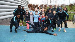 DREAM COME TRUE: City players welcome some very special guests to training.