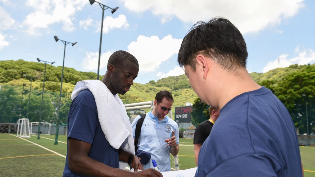 COMMUNITY: Yaya Toure meets participants at the Unified Schools Football Training project in Beijing