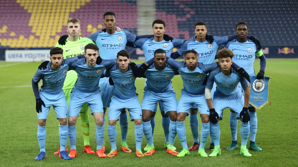 LINEUP: City's eleven pose for the traditional pre-match photo