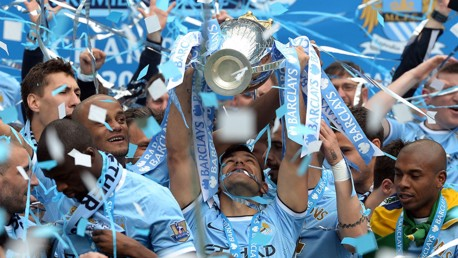 SUCCESS: Sergio lifts his second Premier League title in 2014.