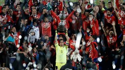 ON TOP OF THE WORLD: Claudio Bravo was the first Chilean to lift the Copa America.
