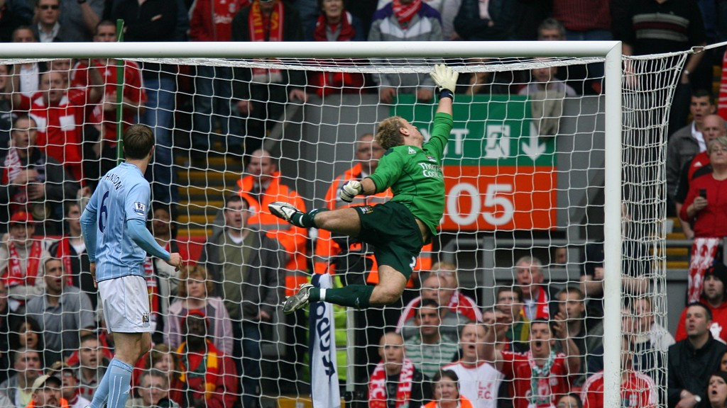 STRIKE A POSE: Hart is frozen in mid-air as he tips a shot over the bar against Liverpool in 2006
