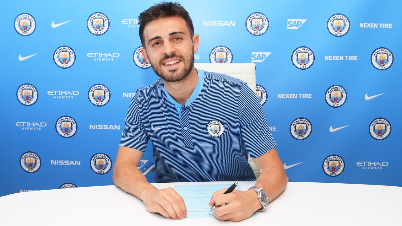 SIGNING: Bernardo Silva signs the dotted line