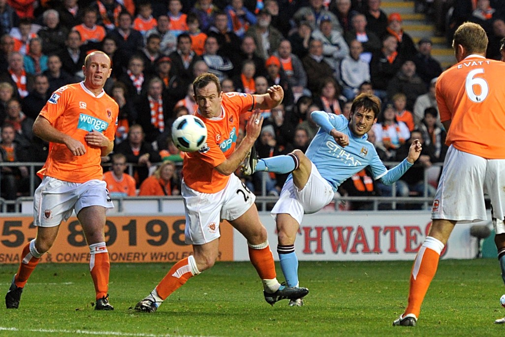 FINESSE: Silva curls in his first City goal against Blackpool in 2010