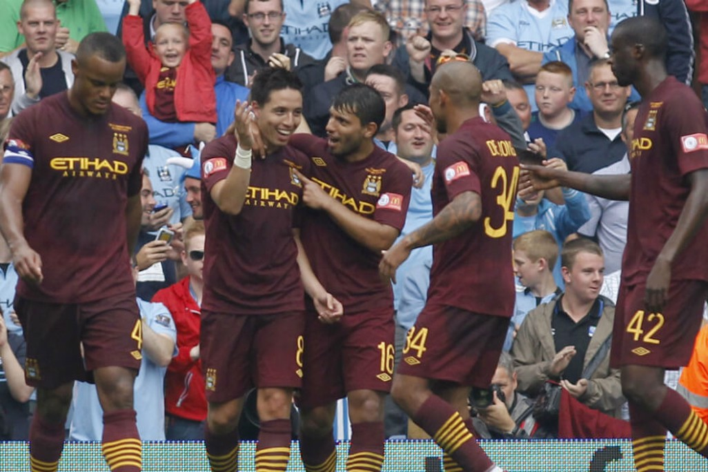 MOBBED: Congratulated after scoring in the 2012 Community Shield win.