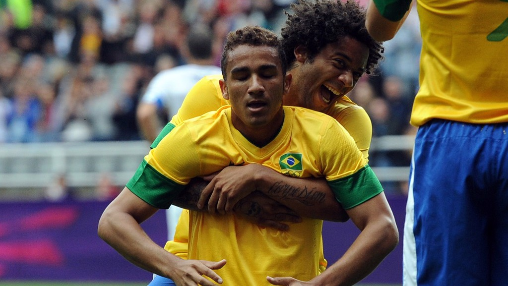 2012: Danilo celebrates scoring for Brazil with Real Madrid's Marcelo during the 2012 London Olympics