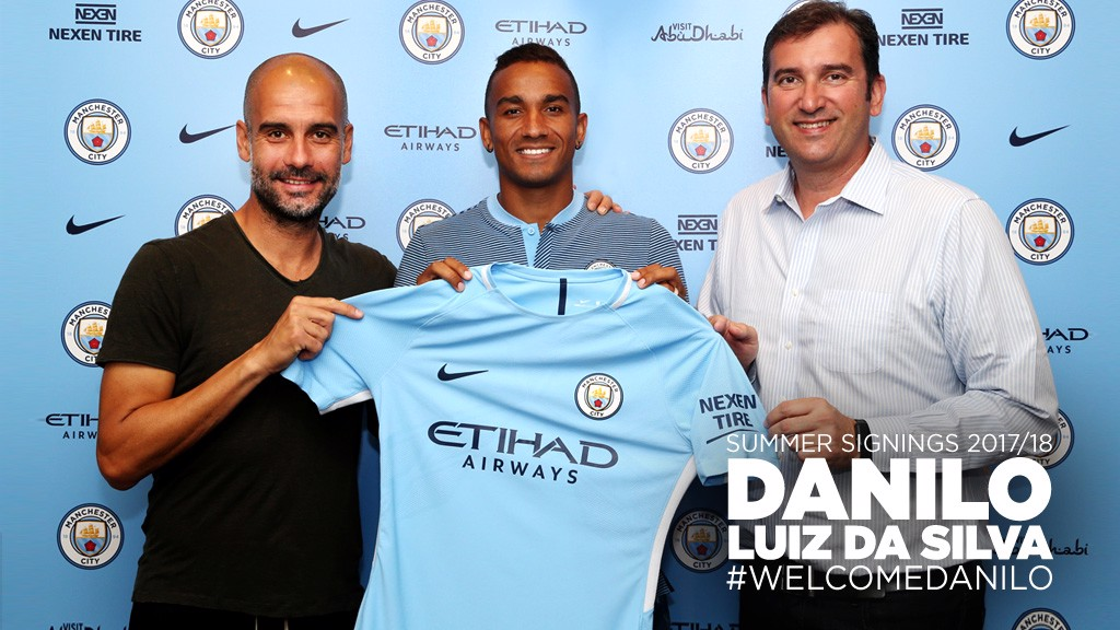 DEAL ME IN: Boss Pep Guardiola, Danilo and Chief Executive Ferran Soriano