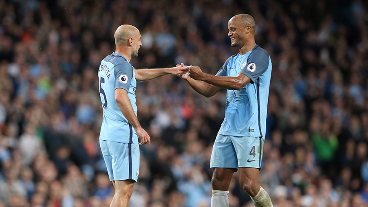 CAPTAIN: Vincent Kompany gives Pablo Zabaleta the captain's armband.