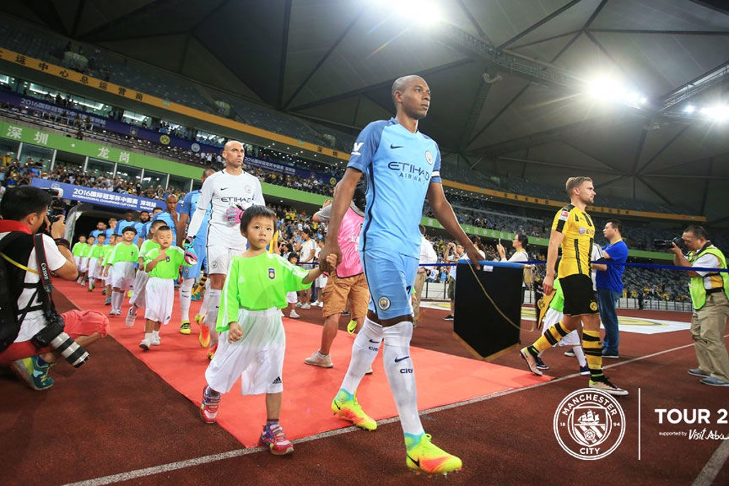 HERE WE GO: Captain Fernandinho leads the team out onto the Longgang Stadium pitch.