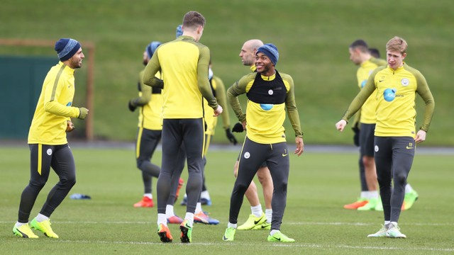 LAUGHING: No doubt John's equally as amused as Raheem.