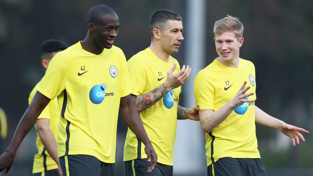 JOKES: Toure, Kolarov and De Bruyne share a joke in training.