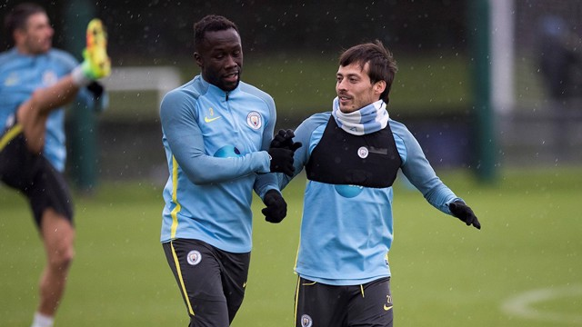 HIGH FIVE: David Silva and Bacary Sagna come together during a training drill