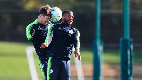 HEAD BOYS: John Stones rises with Raheem Sterling to contest this aerial challenge