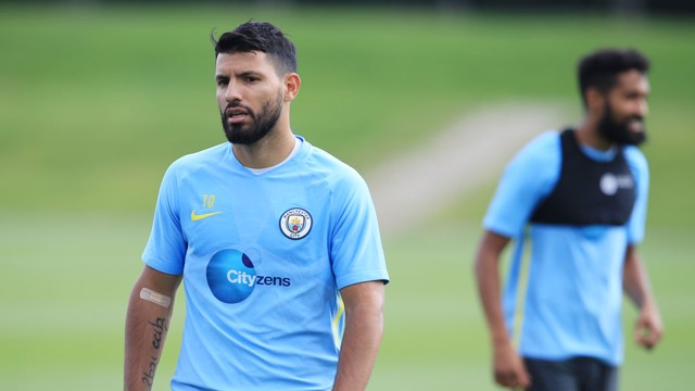FOCUS: Sergio watches on with Gael Clichy in the background - battle of the beards!