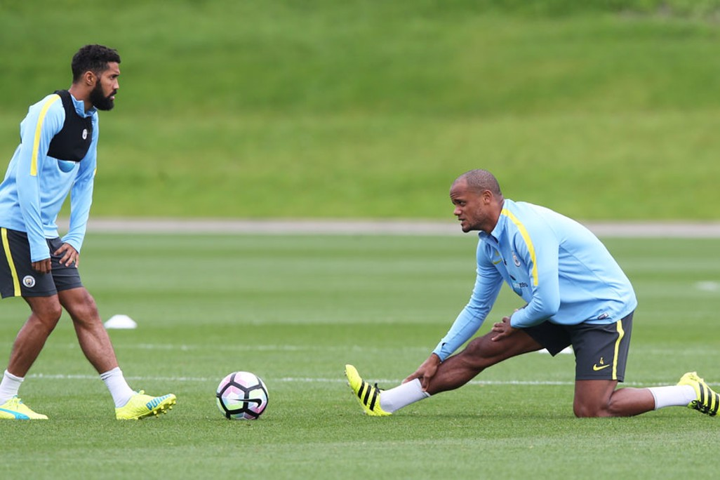 LIMBERING: Vincent Kompany and Gael Clichy stretch for success.