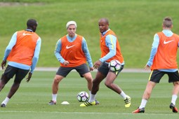 THICK OF IT: Kompany and Nasri in full flow.
