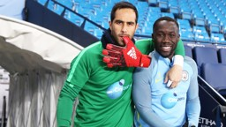 COOL GUYS: Claudio Bravo and Bacary Sagna notice the camera on their way out of the tunnel
