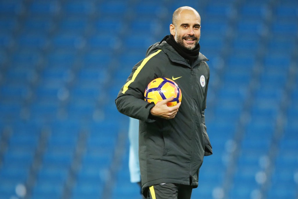 CLOSE TO HIS CHEST: Pep Guardiola is known for always keeping a ball close