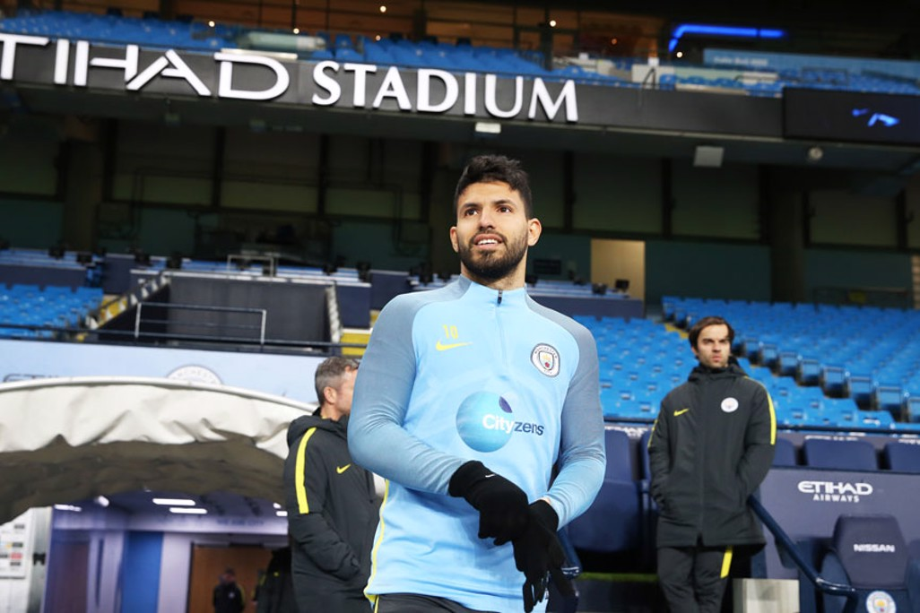 GLOVES ON: Aguero looks out across the pitch on which he has scored so many important goals