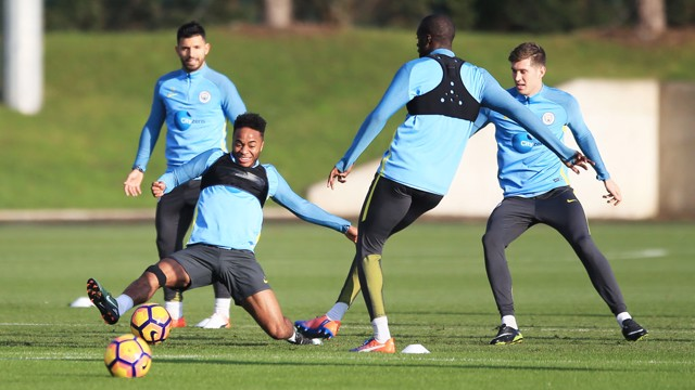 HARD WORK: Tackles flying in from Raheem Sterling.