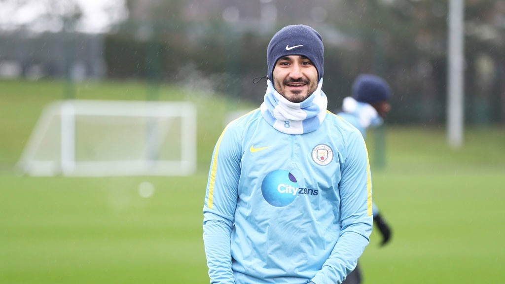 HAPPY: Gundogan has a quick peep and smile at the camera.
