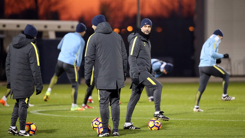 ON THE BALL: Manager, Pep Guariola steps on the ball in training