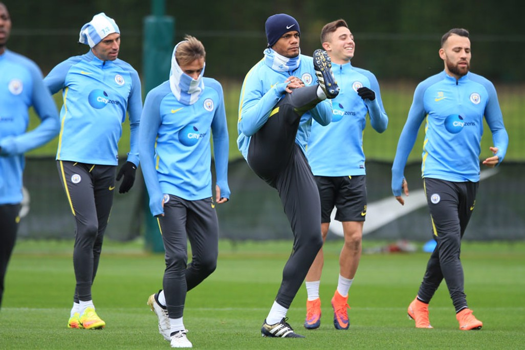 HIGH FOOT: Kompany warms up during training