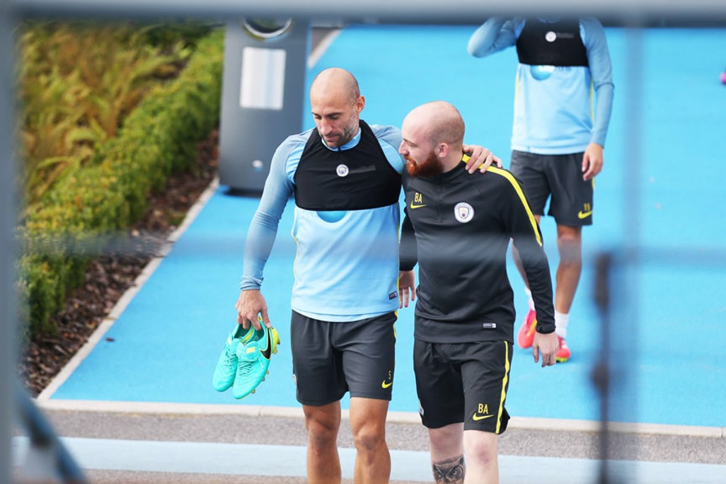 COME HERE: Zaba and kitman Brandon make their way to the pitch.