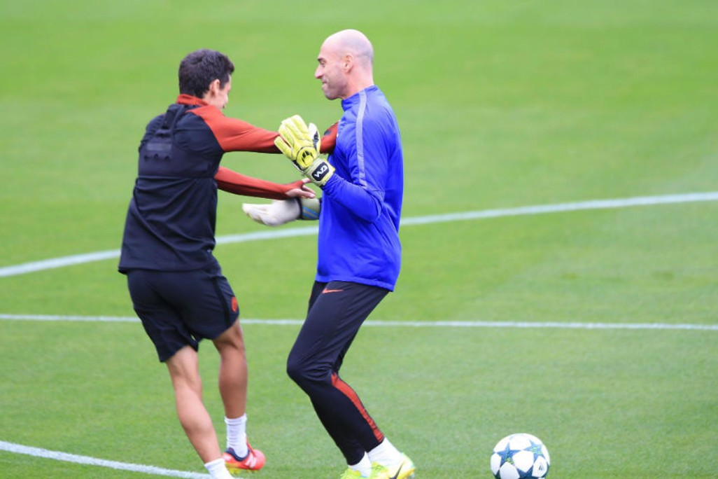 CATCH ME IF YOU CAN: Willy Caballero gets to grips with Jesus Navas