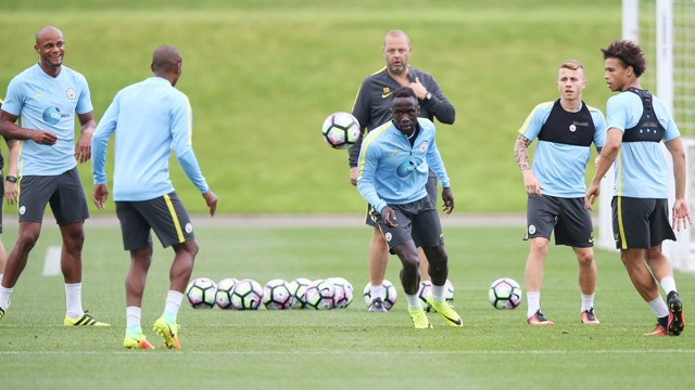 ONE IN FIVE OUT: Sagna chases the ball in the middle