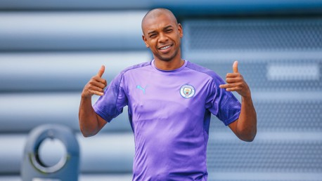 SAY CHEESE: Fernandinho looks delighted to be back