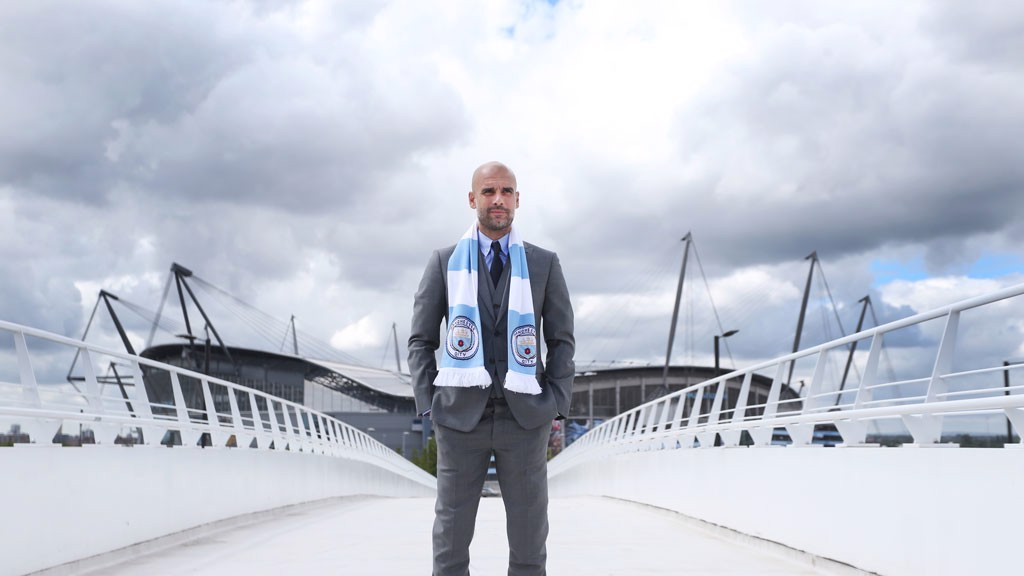 NEW TERRITORY:  Guardiola surveys his surroundings, having chosen to manage City and test his mettle in the Premier League