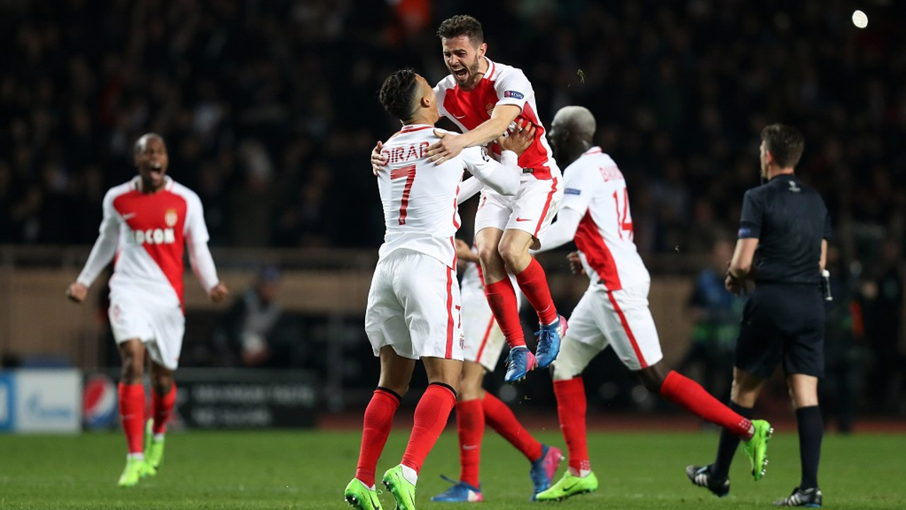 Job done - the Monaco players celebrate beating City 3-1