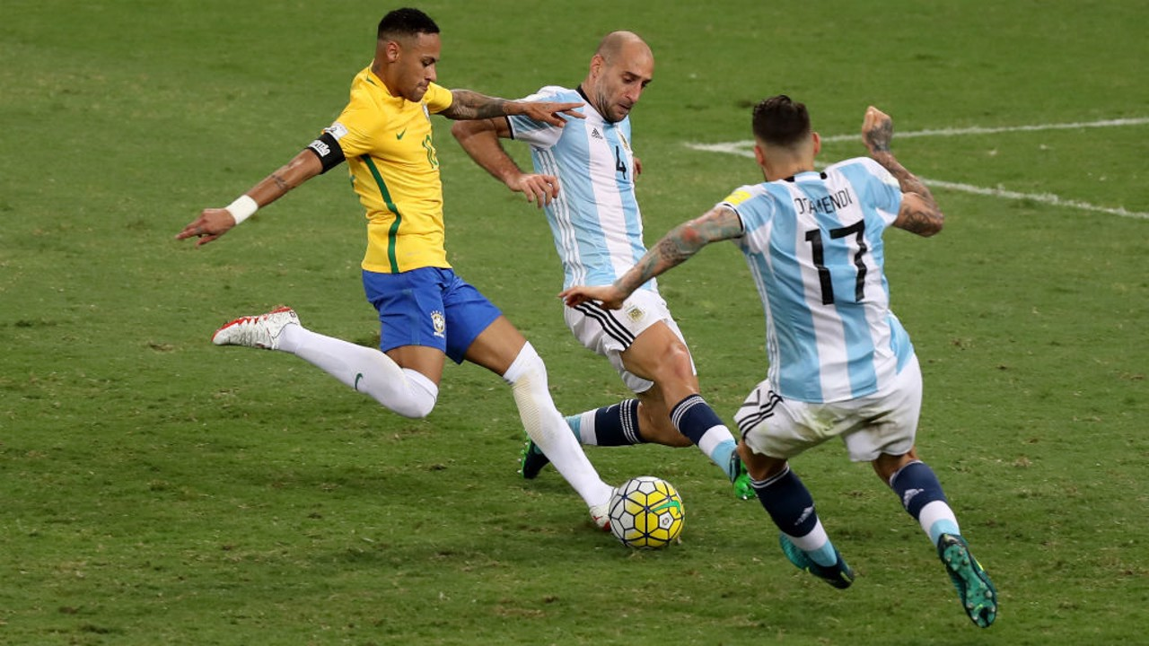 CLOSING IN: City's Argentinian duo Pablo Zabaleta and Nicolas Otamendi challenge Neymar