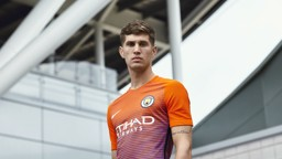 JERSEY BOY:  John Stones models the new third shirt.