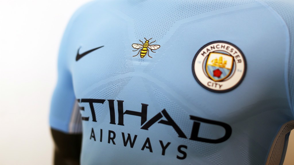 SYMBOL OF A CITY: The bee logo on Manchester City's shirt