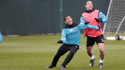Two whole-hearted competitors, Tevez and Zabaleta, give it their all in a bid to win the ball