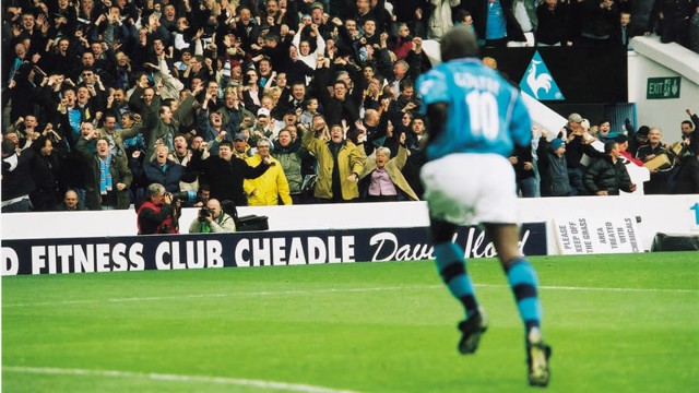 Maine Road explodes after Shaun Goater picks Gary Neville's pocket.