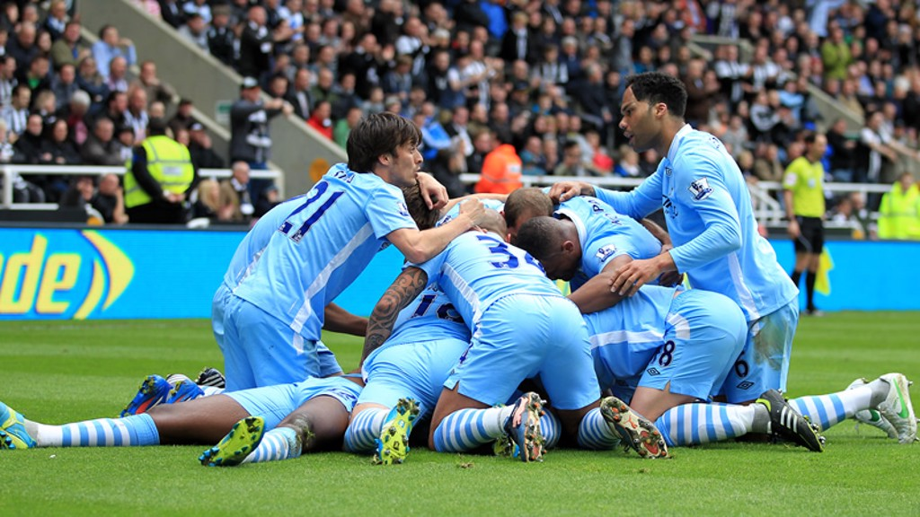 David Silva advises on first aid for an overwhelmed Yaya Toure.