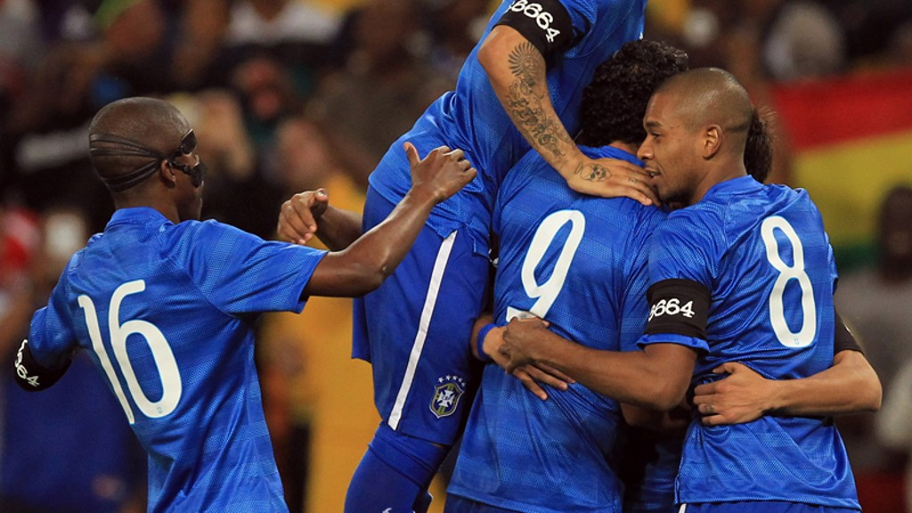 Fernandinho celebrates with his Brazilian teammates in their 5-0 win