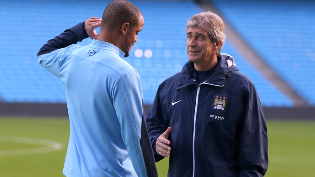 Manuel talks tactics with the captain at the Etihad Stadium in an early training session.