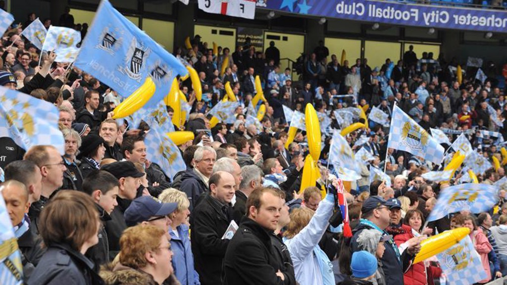 Crowd waving flags and bananas at Man City vs Hamburg at City of Manchester Stadium 0809