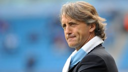 Mancini watches warm up from the touchline
