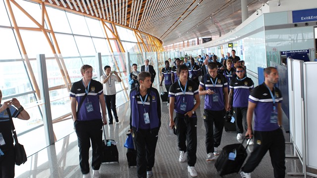 Manchester City squad arrive in Beijing