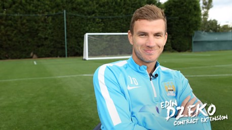 Dzeko signs four-year deal at City