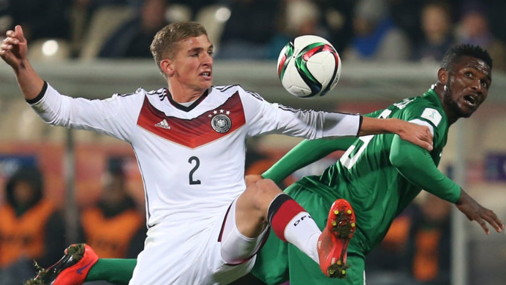 Germany's Grischa Proemel, left, fights for the ball against Nigeria's Success Isaac